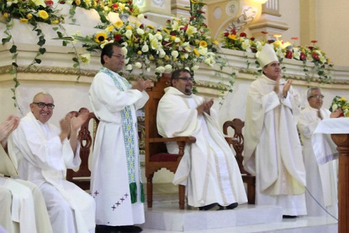 seated: Fr. Oswaldo at his installation as pastor together with the bishop of Orizaba